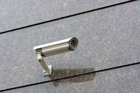 Surveillance Camera mounted on a granite wall. Zdjęcie Seryjne