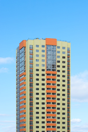 KIEV, UKRAINE - 7 March 2014: Bright apartment house on a background of blue sky and clouds. Photo Editorial Use Only.