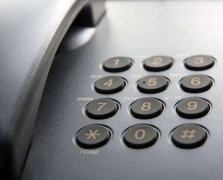Fragment of black landline phone. Photographed in backlit. Shallow DOF Zdjęcie Seryjne