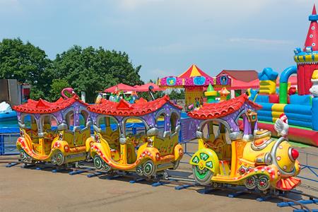 KIEV, UKRAINE - 7 June 2014: Colorful children attractions train. Amusement Park Kiev Ukraine. Photo Editorial Use Only.