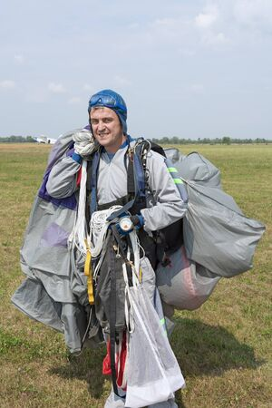 Landed on the airfield skydiver with an open parachute.