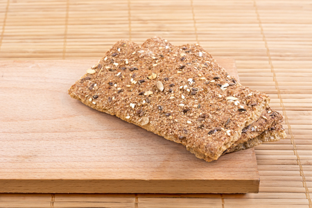 Crispbread with a variety of seeds on the board.