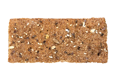 Crispbread with a variety of seeds. Isolated on white background. Zdjęcie Seryjne