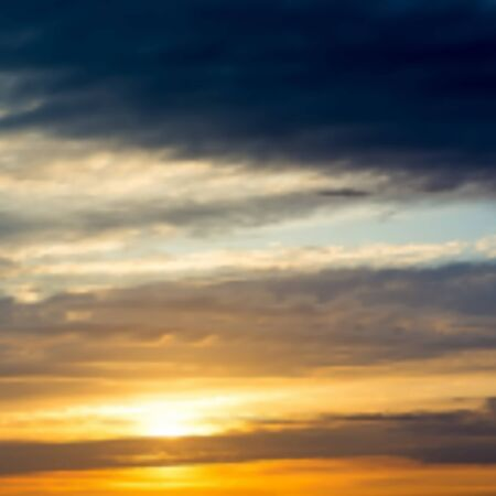 sunset clouds: Blurred background with sunset  sunrise in the sky with dramatic clouds.