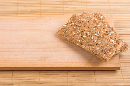 crispbread: Crispbread with a variety of seeds on the board.