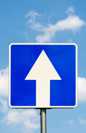 heaven: OneWay traffic road sign against a blue sky and clouds. Concept: The road to heaven. Closeup. Stock Photo