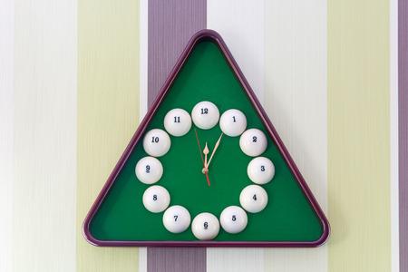 Beautiful wall clock in the style of billiards. Close-up. Zdjęcie Seryjne - 43772073