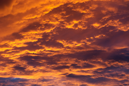 Sunset in the sky with dramatic clouds.