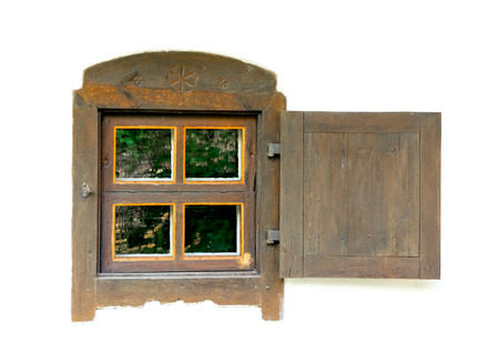 Old wooden window on a white wall village house. The reflection flowers in the glass. Standard-Bild