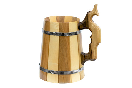 Wooden beer mug with metal hoops. Isolated on white background.