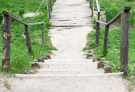 Wooden bridge with a handrail on a country road. View from above. Standard-Bild