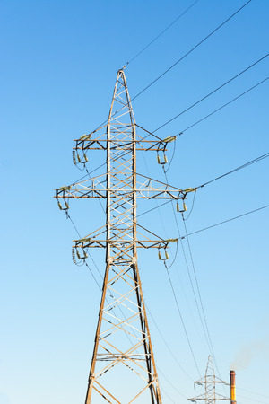Supports for high-voltage power line against the blue sky.