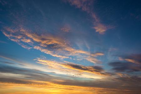 Beautiful sunset with dramatic cirrus orange clouds.