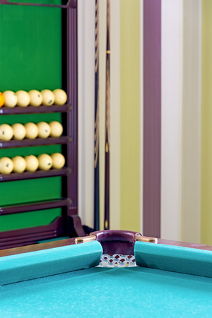 pool room: Corner of the pool table in the interior of the billiard room. Close-up Stock Photo