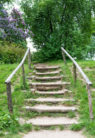 Old wooden staircase on a country road.