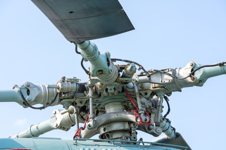 Main rotor helicopter large close-up against the sky.