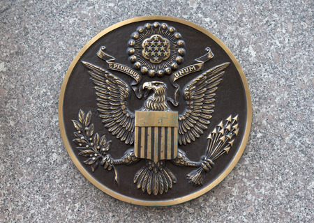 Bronze seal of the United States on marble