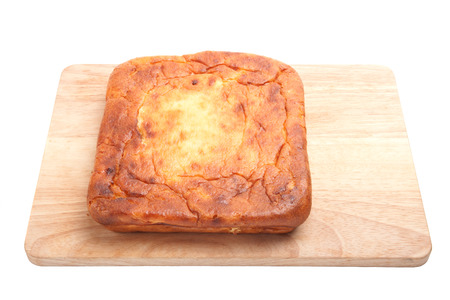 Cottage cheese pie on a wooden board on a white background photo