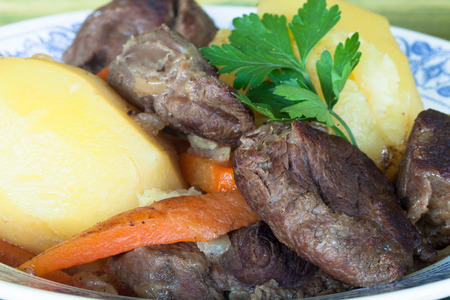 pot roast with chunks of whole potatoes and carrots  parsley photo