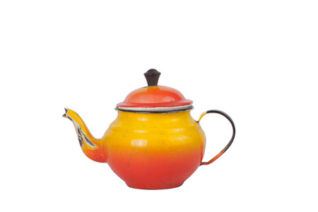 stovetop: old dirty enamel teapot isolated on white background