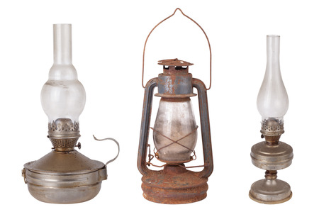 Three antique kerosene lamps isolated on white background photo