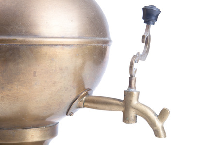 old brass samovar isolated on a white background photo