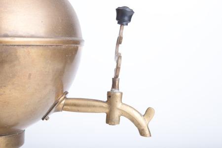 old brass samovar on a white background photo
