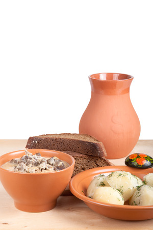 chiken: Soup of chiken liver and boiled potato with dill on a wooden board Stock Photo