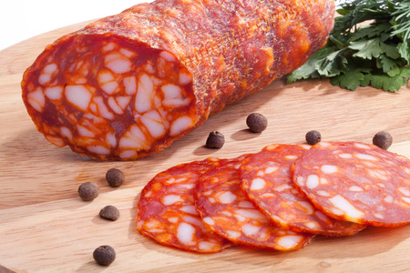 chorizo sausage with herbs and pepper on the board Standard-Bild