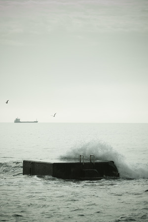 Breaking Waves on Pier.tinted photo