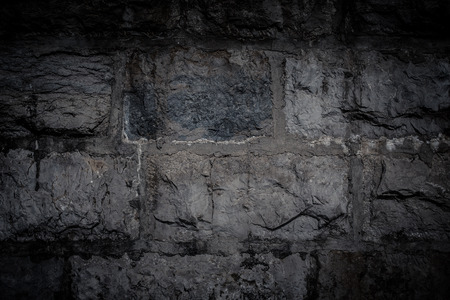 Natural stones are folded in wall. Background. photo