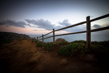 Wooden fence on Cape Roca (cabo da roca) photo
