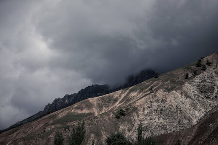 wheather: Clouds at the mountains. Stormy wheather. Black-white. Stock Photo