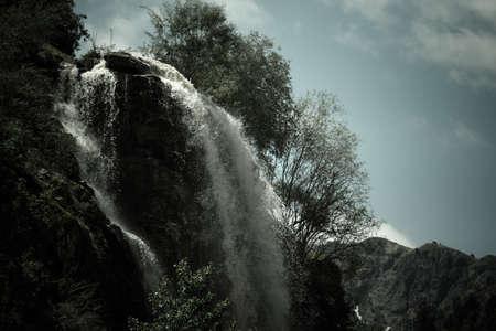 Waterfall in the mountains. Dramatic landscape. Tajikistan photo