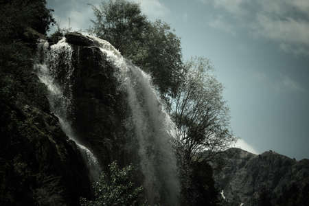 spring  tajikistan: Waterfall in the mountains. Dramatic landscape. Tajikistan Stock Photo