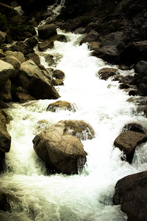 hardwoods: Stream of mountain river. Toned. Dramatic Stock Photo