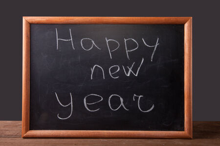 inscription Happy new year in chalk on the blackboard photo