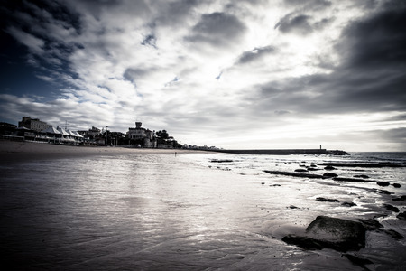 dramatically: Cascais embankment at low tide. dramatically Stock Photo