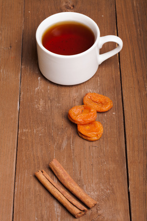 fireclay: cup of tea on an old wooden table. small depth of field Stock Photo