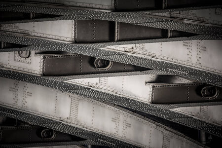 riveted metal from bridge, textural background photo