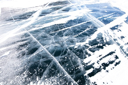 View of beautiful drawings on ice from cracks and bubbles of deep gas on surface of Baikal lake in winter, Russia photo