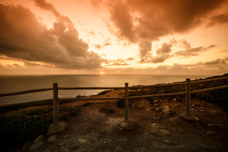 Wooden fence on the edge of Europe. Sunset. tinted photo