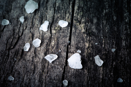 sea salt in an old utensils on wooden table photo