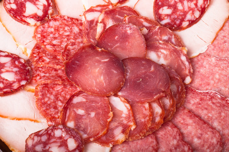 The background - detail of sliced salami photo