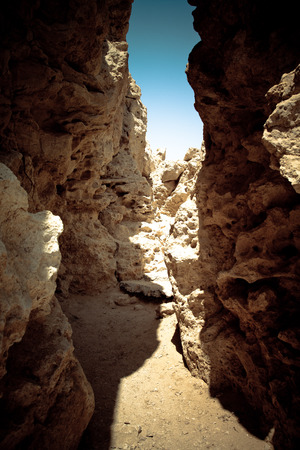 fissure: Crevice in the rock, forming a tunnel. tinted
