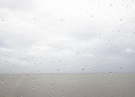 seaview: Seaview through the raindrops on window. Stock Photo