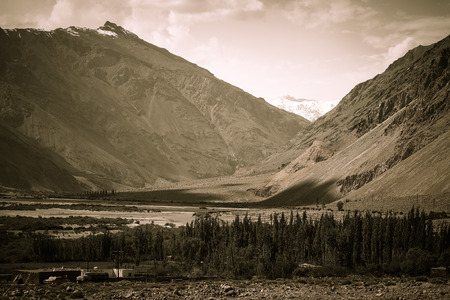 spring  tajikistan: The valley at the foot of the mountains on Pamir. Spring. Tajikistan. Toned. Stock Photo