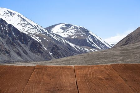 spring  tajikistan: Wood flooring with a view of the sky over the mountains. Stock Photo