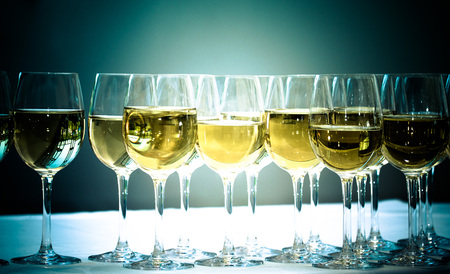 stemware: Stemware of champagne on a white table. Banquet. Toned.
