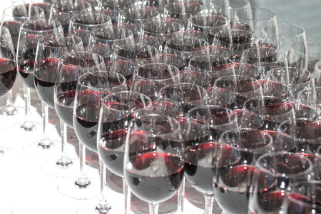 stemware: Stemware of red wine on a white table. Banquet.